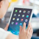 Woman with Apple iPad Air